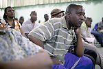 JWANENG, BOTSWANA - SEPTEMBER 24: Unidentified mine workers listens to union leaders during a meeting at Jwaneng, the richest diamond mine in the world on September 24, 2009 in Jwaneng, Botswana. It's owned by Debswana, a partnership between the De Beers Company and the government of Botswana. The mine employs about 3000 people and is also processing ore for the mine as well as two of Debswana's other mines. The truck can carry about 245 tons of ore each time. The mine operates 24 hours a day, all year around. Diamond wealth has brought lots of revenues to Botswana, including an impressive infrastructure such as roads and free education up to university. (Photo by Per-Anders Pettersson)..