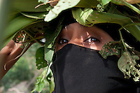 """Green"" by Amira Al Sharif.  A Yemeni Women,Fatom Ahmed, 30, collect grass in Haja'ah."