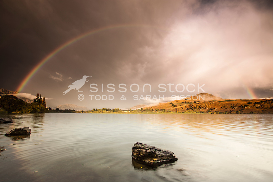 A spectacular rainbow over Lake Hayes, Queenstown New Zealand on an autumn (fall) morning.
