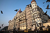 Pigeons flies around the Taj Mahal Hotel, one of the sites of the 2008 terrorist attacks, in Mumbai, India. Photograph: Sanjit Das