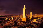 Headstones in cemetery, storm at sundown, Deep Creek Range, Ibapah, Utah.