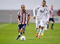 CARSON, CA - March 17, 2012: Chivas USA midfielder Peter Vagenas (6) during the Chivas USA vs Vancouver Whitecaps FC match at the Home Depot Center in Carson, California. Final score Vancouver Whitecaps 1, Chivas USA 0.