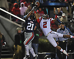 Ole Miss wide receiver Lionel Breaux (21) is defended by Louisiana-Lafayette's Orkeys Auriene (2)  in Oxford, Miss. on Saturday, November 6, 2010. The pass was incomplete. Ole Miss won 43-21.