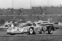 DAYTONA BEACH, FL - FEBRUARY 3: The race-winning Porsche 962 104 driven by A.J. Foyt, Bob Wollek, Al Unser and Thierry Boutsen on the infield road course during the 24 Hours of Daytona on February 3, 1985, at the Daytona International Speedway in Daytona Beach, Florida.