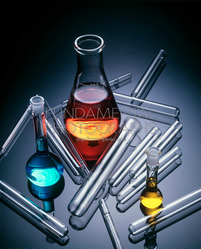 LABGLASS: SOLUTIONS IN FLASKS WITH TEST TUBES<br /> Samples of Borosilicate Glass.<br /> Pyrex and Kimax borosilicate glassware which is in a range of heat- and chemical-resistant glasses prepared by fusing together boron(III) oxide, silicon dioxide, and, usually, a metal oxide.