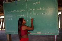Indigenous school, native girl writes on blackboard in classroom, Espirito Santo do Rio Curupi Village, Karipuna do Amapa Indigenous People, Amapa State, Amazon rainforest, northern Brazil.