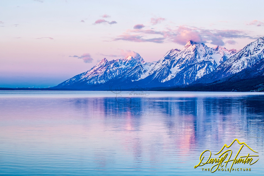 Grand Teton sunrise from Jackson Lake Overlook.  The Grand Tetons reflect upon the rarely calm water of Jackson Lake in Grand Teton National Park.