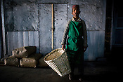 55 year old Factory worker, Indrey Sarki poses for a portrait at Makaibari Tea Estate factory, Kurseong in Darjeeling, India.