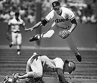 San Francisco Giants Robby Thompson jumps over Los Angles Dodger Mike Scioscia to complete doubleplay.<br />(1986 photo by Ron Riesterer)