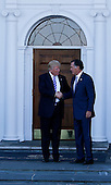 Mitt Romney (L) leaves after meeting with United States President-elect Donald Trump (R) and Vice President-elect Mike Pence (unseen) at the clubhouse of Trump International Golf Club, November 19, 2016 in Bedminster Township, New Jersey. <br /> Credit: Aude Guerrucci / Pool via CNP