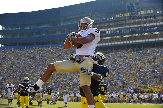 Michael Floyd catches a touchdown pass in the second quarter against Michigan in Ann Arbor.