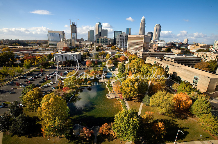 The Charlotte skyline with Marshall Park in the foreground. The park was originally constructed in 1973 as an Urban Renewal project. A 1.24 acre pond and fountain sit in the middle of the park. The park provides an open green space for citizens and lunch time patrons and is also capable of housing small to medium size events. The park is located at 800 East Third Street, the park covers 5.43 acres and is bordered by East Third Street, South McDowell Street, the Charlotte-Mecklenburg Board of Education, and First Baptist Church.