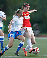 Western New York forward Adriana Martin Santamaria (20) controls the ball as Boston Breakers defender Taryn Hemmings (25) pressures. In a Women's Premier Soccer League Elite (WPSL) match, the Boston Breakers defeated Western New York Flash, 3-2, at Dilboy Stadium on May 26, 2012.