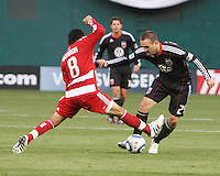Brandon Barklage #24 of D.C. United is tackled by Bruno Guarda #8 of F.C. Dallas during a US Open Cup match on April 28 2010, at RFK Stadium in Washington D.C. United won 4-2.