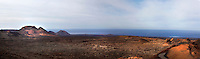 Panoramic view of the Timanfaya National Park, Lanzarote, Canary Islands, Spain, pictured on November 25, 2010 in the afternoon. Timanfaya National Park was founded in 1968. It contains the Montanas del Fuego (Fire Mountains) which were created by more than 100 volcanic eruptions in 1730 and 1736 which devastated the area. Due to the arid climate, and consequent lack of erosion, this area has hardly changed since the last eruptions in 1824. Lanzarote, the Easternmost of the Canary Islands, lies 125km East of the African coast, in the Atlantic Ocean. Like the other islands in this autonomous Spanish archipelago, Lanzarote is originally Volcanic. Picture by Manuel Cohen.