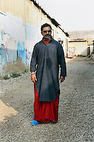 Yousuf Bashir Kureshi photographed at his Commune Gallery in the docks area of Karachi.