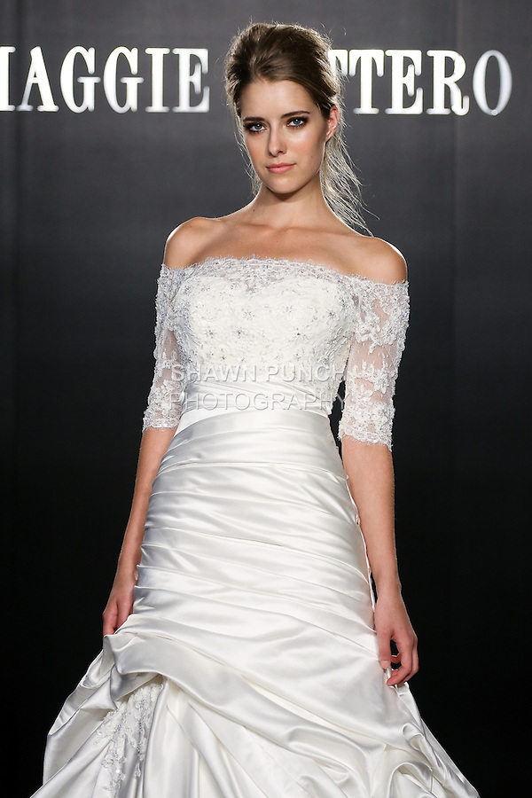 Model walks the runway in a Symphony Couture wedding dress from the Maggie Sottero Bridal Spring 2012 collection, during  Couture: New York Bridal Fashion Week 2012