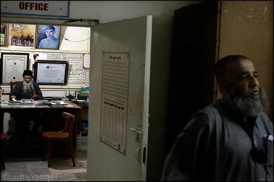 abdul sattar edhi in his boultan market, karachi office - the same location where he first began his work