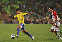 Brazil's Bertucci takes the ball past Costa Rica's defense during the FIFA Under 20 World Cup Semi-final match at the Cairo International Stadium in Cairo, Egypt, on October 13, 2009. Brazil won the match  1-0.