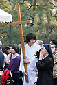 April 11, 2011, Kamakura, Japan - A Christian altar boy holds a large cross during a special commemorative event at Hachimangu Shrine to offer prayers for the relief of the March 11 earthquake and tsunami victims. Today is exactly one month since the devastating disaster that left Tohoku with almost nothing to spare. (Photo by Christopher Jue/AFLO) [2331].
