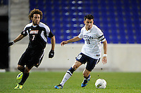 Carlos Alvarez (10) of the Connecticut Huskies is defended by Nick DeLeon (7) of the Louisville Cardinals during the first semifinal match of the Big East Men's Soccer Championships at Red Bull Arena in Harrison, NJ, on November 11, 2011.