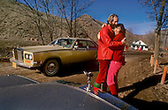 Wasco, Oregon, February 1984: Disciples of Bhagwan Rajneesh express openly their mutual love to one another in front of a Rolls-Roys car. Bhawan Rajneesh (now known as Osho) possessed more than 20 Rolls-Royce cars and never used the same car two days in a row.  Rajneeshpuram, was an intentional community in Wasco County, Oregon, briefly incorporated as a city in the 1980s, which was populated with followers of the spiritual teacher Osho, then known as Bhagwan Shree Rajneesh. The community was developed by turning a ranch from an empty rural property into a city complete with typical urban infrastructure, with population of about 7000 followers.
