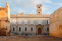 Low angle view of church of St Anthony of Padua, late 19th century, in a deserted ruined street, El Jadida, Morocco. The Spanish convent church is an example of religious co-habitation in this Atlantic port city. El Jadida, formerly Mazagan, was occuped by the Portuguese from 1502 to 1769. Picture by Manuel Cohen
