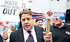1st June 2013 <br /> <br /> Protest around Westminster <br /> <br /> Nick Griffin, leader of the British National Party (BNP) speaking on College Green outside the Palace of Westminster in an area cordoned off by Police keeping supporters of United Against Fascism (UAF) and the BNP group apart. The BNP had been banned from marching in Woolwich and moved their rally to Westminster hoping to lay flowers at the Cenotaph in Whitehall but were prevented from doing so. <br /> <br /> A spokesman said: &ldquo;Due to police concerns about serious disruption to the life of the community, and the potential for serious disorder should this counter protest confront the BNP organised protest, police have imposed conditions under Section 14 of the Public Order Act.<br /> <br /> Photograph by Elliott Franks