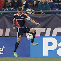 New England Revolution defender Chris Tierney (8) controls a long pass. In a Major League Soccer (MLS) match, the New England Revolution (blue) tied New York Red Bulls (white), 1-1, at Gillette Stadium on May 11, 2013.