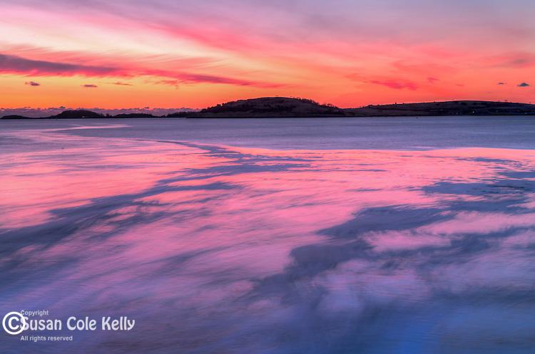 Sunrise over the Boston Harbor Islands seen from Pleasure Bay, South Boston, Massachusetts, USA