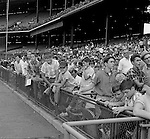 Pittsburgh PA: View of fans waiting for players to sign autographs before the start of the HYPO Charity game between the Pittsburgh Pirates and Milwaukee Braves at Forbes Field.<br />