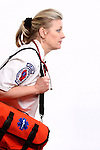 A Wisconsin EMT with a medical bag in a hurry