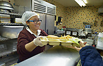 A student works in the cafeteria in the Lydia Paterson Institute in El Paso, Texas, where most of the students cross the border every day from their homes in Juarez, Mexico, to study at the United Methodist-sponsored high school. Many repay part of their scholarship by working in the cafeteria or helping to clean the school.