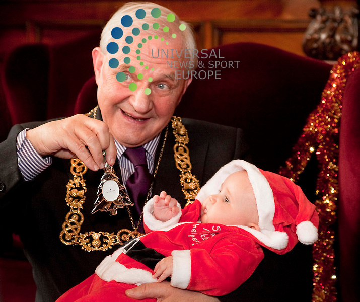Glasgow Lord Provost Bob Winter, with three-month-old Lucy Lambert, Babies' First Christmas.drive. Mums and dads of babies celebrating their first Christmas can.register and receive a certificate and silver Christmas Tree trinket.    .Picture Johnny Mclauchlan/Universal News and Sport (Scotland)27/10/2010