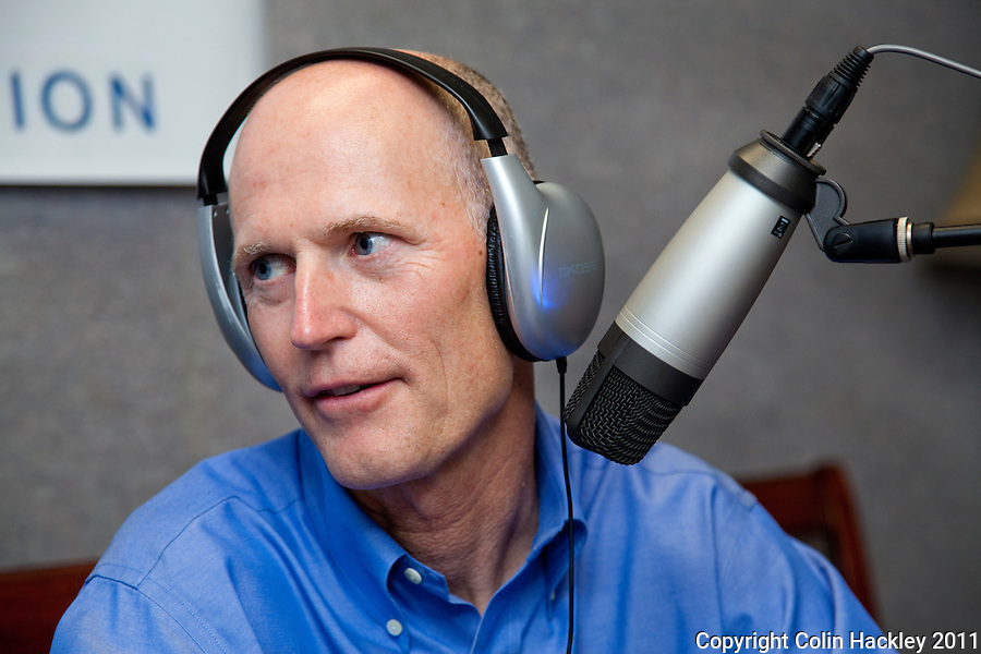 TALLAHASSEE, FLA. 7/28/11-SCOTTRADIO HACKLEY05-Gov. Rick Scott responds to questions from radio talk show host Jay Green during Green's show on gospel radio station WHBT 1410 AM, Thursday in Tallahassee. Recently Scott has been appearing on talk radio across the state several times a day as a way to get his message out to Floridians..COLIN HACKLEY PHOTO