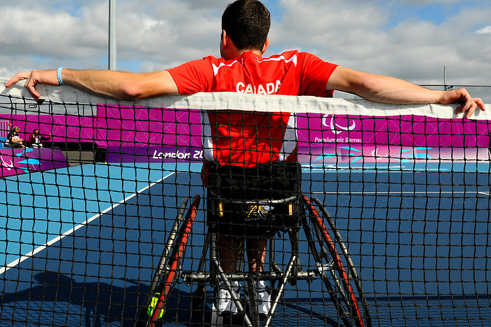 London, England 26/08/2012 - Joel Dembe stretches before a training session at the London 2012 Paralympic Games in Eton Manor. (Photo: Phillip MacCallum/Canadian Paralympic Committee)