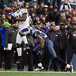 Baltimore Ravens Wide receiver Anquan Boldin, left, drops the ball after getting hit by Seattle Seahawks corner back Brandon Browner in the third quarter against the at  CenturyLink Field in Seattle, Washington on November 13, 2011. The Seahawks beat the Ravens 22-17.   ©2011 Jim Bryant Photo. All Rights Reserved.