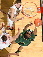 Dec. 20, 2010; Charlottesville, VA, USA; Norfolk State Spartans guard/forward Rodney McCauley (15) shoots the ball in front of Virginia Cavaliers guard Joe Harris (12) and Virginia Cavaliers forward Will Regan (4) during the game at the John Paul Jones Arena. Virginia won 50-49. Mandatory Credit: Andrew Shurtleff