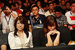 Various expressions as spectators watch the MMA cage fighting<br />