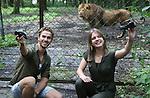 Foto: VidiPhoto<br /> <br /> ARNHEM - In Burgers' Zoo in Arnhem zijn vrijdagmiddag de eerste dierentuinvloggers van Europa gepresenteerd. De 16-jarige Jeanne van den Brink uit Arnhem en de 26-jarige Jeroen Noordzij uit Nijmegen zullen vanaf nu wekelijks hun avonturen voor en achter de schermen van de Arnhemse dierentuin publiceren op het YouTube-kanaal van het dierenpark. Burgers' heeft hiermee een Europese primeur in de dierentuinwereld. Het dierenpark kwam het idee om Video Rangers, zoals ze genoemd worden, in te schakelen omdat vloggen een enorme hype is onder jongeren. De twee vloggers krijgen alle journalistieke vrijheid om hun onderwerpen te presenteren, het moet alleen inhoudelijk en feitelijk correct zijn. De beide Rangers krijgen krijgen voor hun filmwerkzaamheden alleen een onkostenvergoeding.