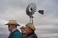 Rancher Larry Cundle, center, with his wife Ruthie and Grant Stumbough, left, a coordinator for Southeast Wyoming Resource Conservation and Development, in a pasture on the Cundles' ranch near Glendo, Wyo., Tuesday, Nov. 11, 2008. Wind energy companies have been scrambling across Wyoming's notoriously windy eastern plains hoping to sign up ranchers for access to install trubines for electricity generation. Many of the ranchers are uncharacteristically banding together to negotiate for better prices for the access. (Kevin Moloney for the New York Times)