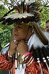 D.Salvatore Timberwolf Lamia dressing in traditional regalia, Tribal Ancestry: Shinnecock Indian Nation, Paukatuck Eastern Pequot. Inter tribal Dancing a celebration of ethnic Native American pride and heritage  at Thunderbird Pow Wow.<br /> <br /> release # 2276, # 2452