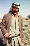 Marsh Arabs. Southern Iraq. Circa 1985. Marsh Arab man with gun.