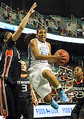 UNC guard Italee Lucas glides past Miami for 2 of her 12 total points. This game was one of the two Semifinal games of the 2011 ACC Tournament in Greensboro on Saturday, March 5, 2011. UNC beat Miami 83-57. (Photo by Al Drago)