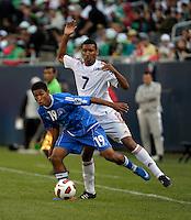 El Salvador's Reynaldo Hernandez evades the challenge by Cuba's Marcel Hernandez.  El Salvador defeated Cuba 6-1 at the 2011 CONCACAF Gold Cup at Soldier Field in Chicago, IL on June 12, 2011.
