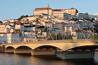 View of the medieval city of Coimbra seen from across the Mondego river, with the University of Coimbra at the summit, with its clock tower, Coimbra, Portugal. The University of Coimbra was first founded in 1290 and moved to Coimbra in 1308 and to the royal palace in 1537. The city dates back to Roman times and was the capital of Portugal from 1131 to 1255. Its historic buildings are listed as a UNESCO World Heritage Site. Picture by Manuel Cohen