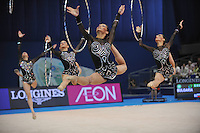September 13, 2009; Mie, Japan;  (Front) Galina Tancheva of Bulgaria rhythmic group split leaps together with group during 5-hoops routine to place 4th in Event Final at the 2009 World Championships Mie, Japan.   Photo by Tom Theobald. .