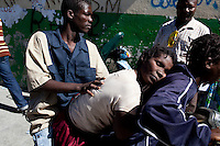 A woman with cholera symptoms arrives at a medical clinic on Tuesday, November 23, 2010 in the Cite Soleil neighborhood of Port-au-Prince, Haiti.