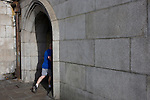 A jogger runs into the underpass beneath Westminster Bridge on London's Southbank,