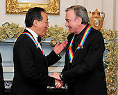 Yo-Yo Ma, left and Neil Diamond, right, two of the five recipients of the 2011 Kennedy Center Honors, shares some thoughts as they wait to pose for a group photo following a dinner hosted by United States Secretary of State Hillary Rodham Clinton at the U.S. Department of State in Washington, D.C. on Saturday, December 3, 2011. The 2011 honorees are actress Meryl Streep, singer Neil Diamond, actress Barbara Cook, musician Yo-Yo Ma, and musician Sonny Rollins..Credit: Ron Sachs / CNP